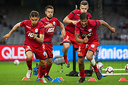 Adelaide United warms up at the Hyundai A-League Round 7 soccer match between Melbourne Victory v Adelaide United at Marvel Stadium in Melbourne, Australia.