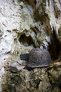 "Photo shows a helmet and other artifacts used by Imperial Japanese Army soldiers in a cave in ""Harakiri Gulch"" in Saipan on 22 February 2011. .Photographer: Robert Gilhooly"