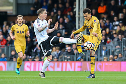 Stefan Johansen of Fulham stretches a leg out to tackle Dele Alli of Tottenham Hotspur - Mandatory by-line: Jason Brown/JMP - 19/02/2017 - FOOTBALL - Craven Cottage - Fulham, England - Fulham v Tottenham Hotspur - Emirates FA Cup fifth round