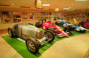 Prince Rainier's race car collection: from l.: vintage Bugatti, Ferrari and Matra Formula One race cars.