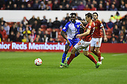 Blackburn Rovers Midfielder Hope Akpan (21) battles with Nottingham Forest midfielder Robert Tesche (32) during the Sky Bet Championship match between Nottingham Forest and Blackburn Rovers at the City Ground, Nottingham, England on 19 April 2016. Photo by Jon Hobley.