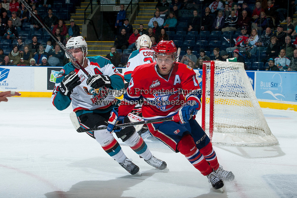 KELOWNA, CANADA -JANUARY 29: Myles Bell #29 of the Kelowna Rockets checks Mitch Holmberg RW #17 of the Spokane Chiefs during the second period on January 29, 2014 at Prospera Place in Kelowna, British Columbia, Canada.   (Photo by Marissa Baecker/Getty Images)  *** Local Caption *** Myles Bell; Mitch Holmberg;