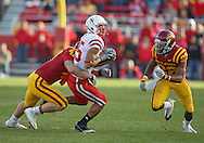 November 06 2010: Nebraska Cornhuskers tight end Kyler Reed (25) is hit by Iowa State Cyclones linebacker A.J. Klein (47) as Iowa State Cyclones cornerback Ter'Ran Benton (22) closes in during the second half of the NCAA football game between the Nebraska Cornhuskers and the Iowa State Cyclones at Jack Trice Stadium in Ames, Iowa on Saturday November 6, 2010. Nebraska defeated Iowa State 31-30.