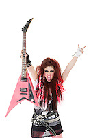 Portrait of young woman with sticking out tongue and holding electric guitar over white background