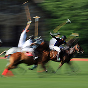 Motion and blur of players in action the Airstream vs. Cinque Terre Polo match at the Greenwich Polo Club, Greenwich, Connecticut, USA. 23rd June 2013. Photo Tim Clayton