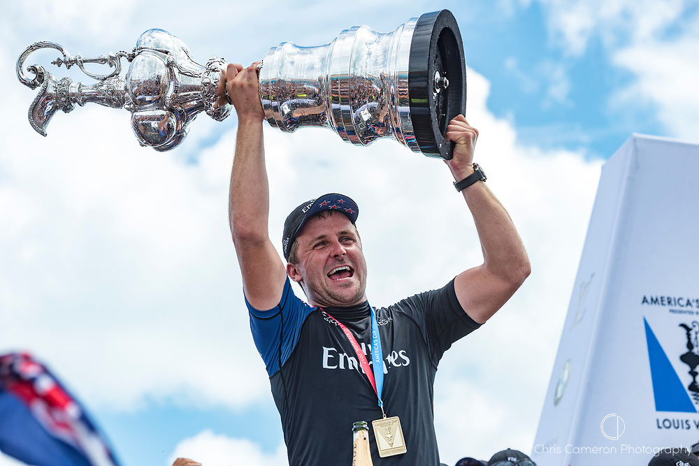 The America's Cup Village, Bermuda, 26th June 2017. Emirates Team New Zealand Sailor / Cyclist Simon Van Velthooven with the America's Cup.