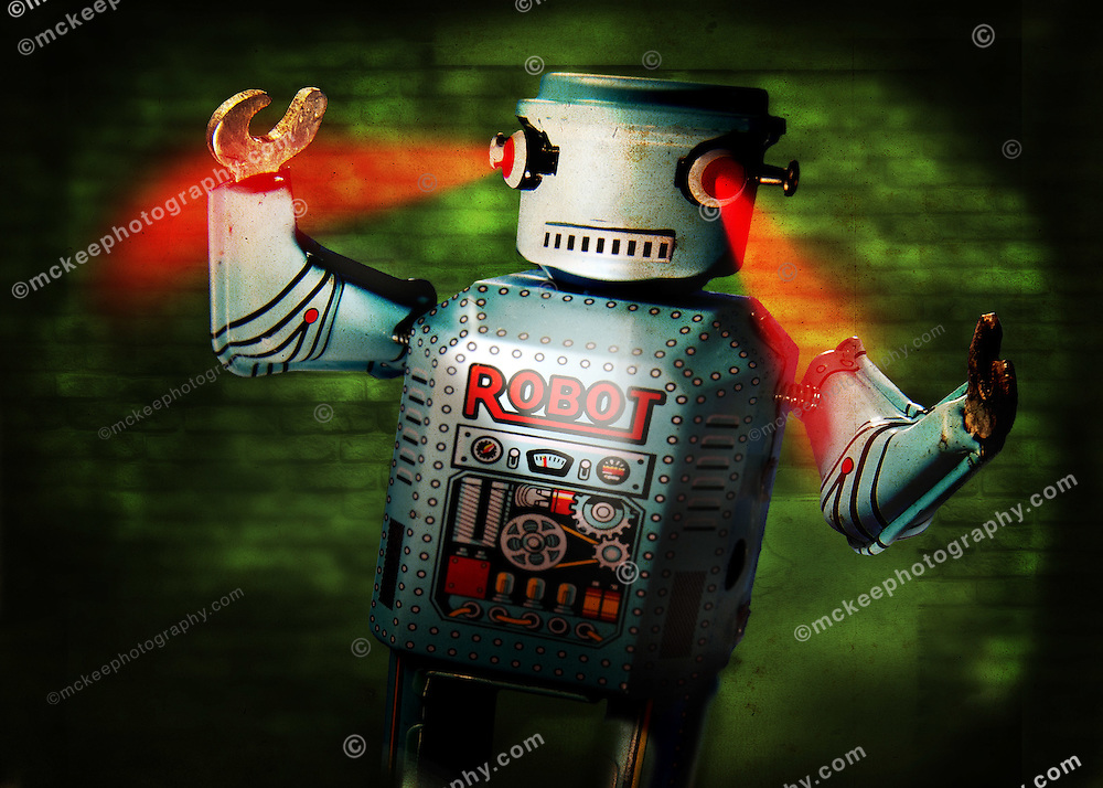Old special effects movie style noir robot attacking with glowing red eyes.