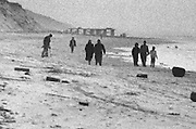 group of people walking on a beach