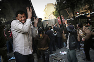 Violent clashes between pro and anti Mubarak in Tahrir Square.<br /> Shielded behind wathever they can grab, anti Mubarak protestors hurl rocks at Egyptian president supporters who tried to invade the square. 02 February 2011.