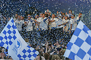 Brighton players celebrate on stage with ticker tape during the Brighton & Hove Albion Football Club Promotion Parade at Brighton Seafront, Brighton, United Kingdom on 14 May 2017. Photo by Phil Duncan.