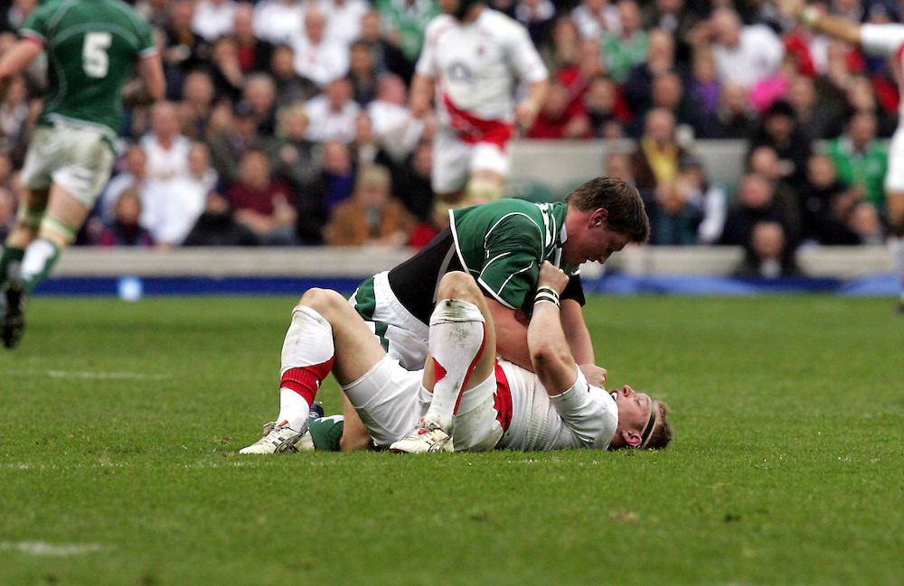 Ronan O'Gara fights with Jamie Noon during the RBS Six Nations game between England and Ireland at Twickenham Stadium, Twickenham, 15th March 2008.