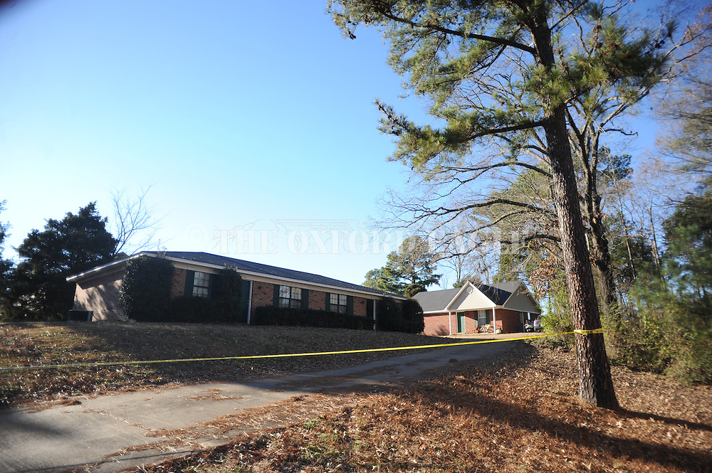 A deputy sheriff stands watch where Ole Miss student Zacharias H. McClendon was found shot to death at 20B County Road 140, also known as Levee Road, near Oxford, Miss., on Wednesday, December 18, 2013.   <br /> According to investigators, foul play is suspected.