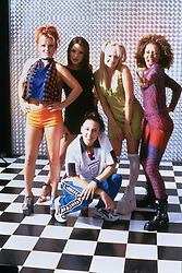 RELEASE DATE: 23 January 1998. MOVIE TITLE: Spice World - STUDIO: Columbia Pictures Corporation. PLOT: The film follows the Spice Girls and their entourage as manager Clifford, his assistant Deborah, filmmaker Piers who is trying to shoot a documentary on 'the real Spice Girls' and others in their everyday life. PICTURED: GERI HALLIWELL as Geri - Ginger Spice with VICTORIA BECKHAM as Victoria - Posh Spice, EMMA BUNTON as Emma - Baby Spice, MELANIE BROWN as Melanie B - Scary Spice and MELANIE CHISHOLM as Melanie C - Sporty Spice. (Credit Image: © Columbia Pictures Corporation/Entertainment Pictures/ZUMAPRESS.com)