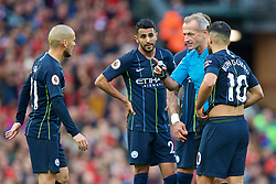 LIVERPOOL, ENGLAND - Sunday, October 7, 2018: Manchester City players surround referee Martin Atkinson during the FA Premier League match between Liverpool FC and Manchester City FC at Anfield. (Pic by David Rawcliffe/Propaganda)