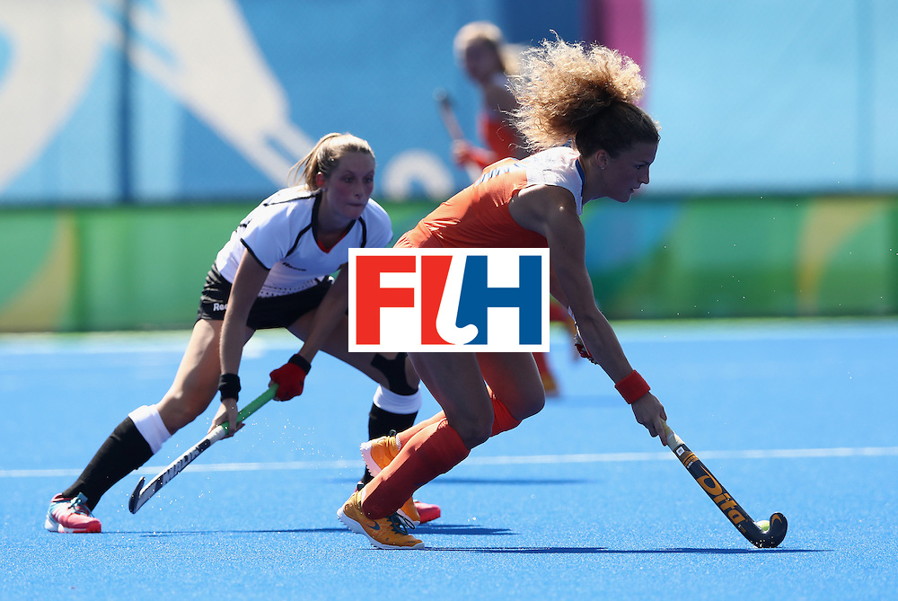 RIO DE JANEIRO, BRAZIL - AUGUST 13:  Maria Verschoor of the Netherlands runs with the ball during the Women's group A hockey match between the Netherlands and Germany on Day 8 of the Rio 2016 Olympic Games at the Olympic Hockey Centre on August 13, 2016 in Rio de Janeiro, Brazil.  (Photo by David Rogers/Getty Images)