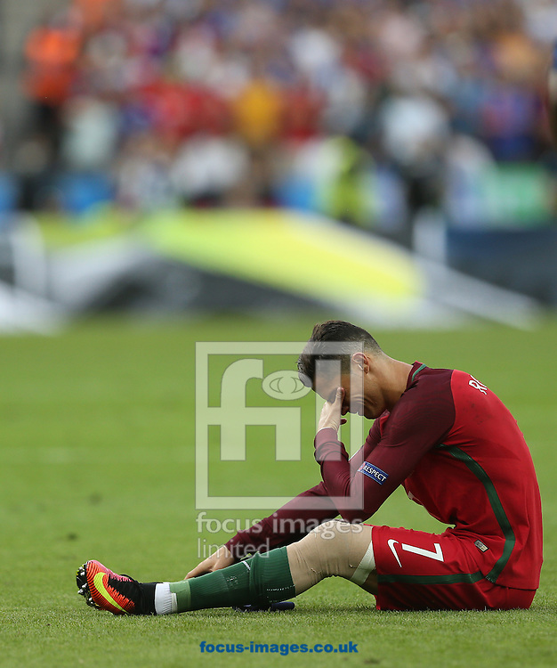 Cristiano Ronaldo of Portugal sits injured on the pitch during the UEFA Euro 2016 Final at Stade de France, Paris<br /> Picture by Paul Chesterton/Focus Images Ltd +44 7904 640267<br /> 10/07/2016