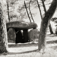 Mané-Kerioned dolmen, 3 dolmens along side the road with accompanying partial stone circle.  Inside the largest of the three, several of the stones were inscribed.  Route D768 in Brittany France.