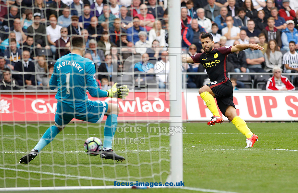 Sergio Aguero scores the first goal for Manchester City during the Premier League match at the Liberty Stadium, Swansea<br /> Picture by Mike Griffiths/Focus Images Ltd +44 7766 223933<br /> 24/09/2016