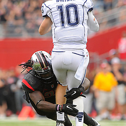 Oct 6, 2012: Rutgers Scarlet Knights linebacker Khaseem Greene (20) hits Connecticut Huskies quarterback Chandler Whitmer (10) as Whitmer releases the football during second half NCAA college football action between the Rutgers Scarlet Knights and UConn Huskies at High Point Solutions Stadium in Piscataway, N.J.