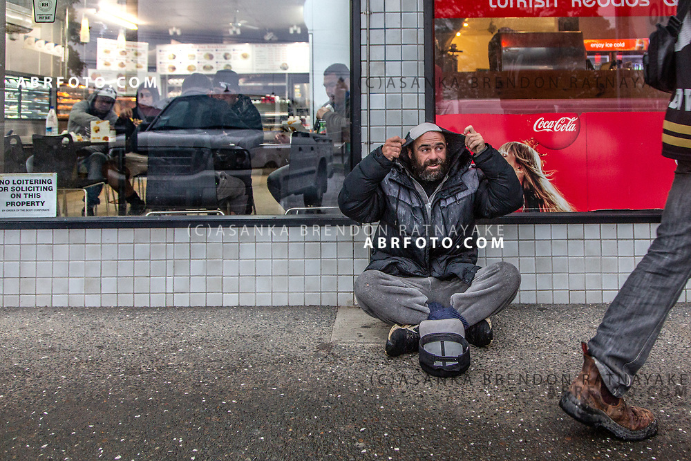 Owen Keane sits outside a Kebab shop at the Henderson shops begging on the 6th of June 2018. Shop owners in Henderson have noted to police that the presence of members of the Homeless has had an adverse effect on business due to anti-social behaviour. Asanka Brendon Ratnayake for The New York Times.