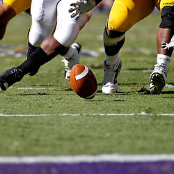 Oct 2, 2010; Baton Rouge, LA, USA; Players for the LSU Tigers and the Tennessee Volunteers scramble for a loose ball during the second half at Tiger Stadium. LSU defeated Tennessee 16-14.  Mandatory Credit: Derick E. Hingle