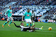Newcastle United midfielder Isaac Hayden (#14) stretches to meet a cross during the EFL Sky Bet Championship match between Newcastle United and Derby County at St. James's Park, Newcastle, England on 4 February 2017. Photo by Craig Doyle.