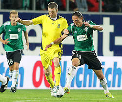 28.07.2011, Keine Sorgen Arena, Ried im Innkreis, AUT, UEFA EL Qualifikation, SV Josko Ried vs Brondby IF, im Bild Mikael Nilsson, (Brøndby IF, Midfield, #08) und Ivan Carril Regueiro, (SV Josko Ried, #13) // during football match between SV Josko Ried (AUT) and Brondby IF (DEN) 1st Leg of Europa League third Qualifying Round, on July 28, 2011 at Keine Sorgen Arena Ried im Innkreis, Austria. EXPA Pictures © 2011, PhotoCredit: EXPA/ R. Hackl