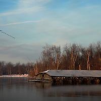 February 1, 2010 - Lexington, Kentucky, USA - As a small flock of Canada geese fly overhead, a nearly full moon sets over Lake Ellerslie. (Credit image: © David Stephenson/ZUMA Press)