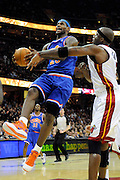 Feb 4, 2010; Cleveland, OH, USA; Miami Heat center Jermaine O'Neal (7) fouls Cleveland Cavaliers forward LeBron James (23) during the first quarter at Quicken Loans Arena. Mandatory Credit: Jason Miller-US PRESSWIRE