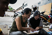 Yanti learns singing from Sinden, a woman singer who sing traditional songs, in folkfore group's lodge in Mojokerto, East Java, Indonesia, June 8, 2015.