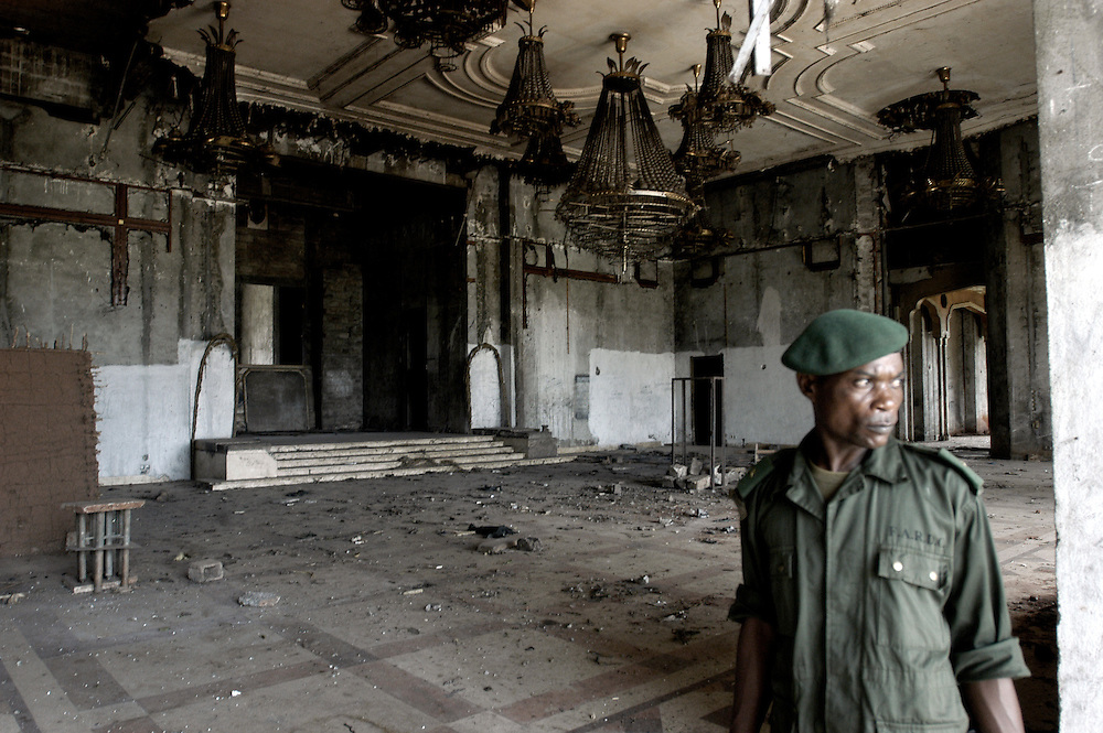 A soldier from the Congolese Armed Forces (FARDC) guards the remains of the Bamboo Palace, one of the extravagant residences built by Mobutu Sese Seko and used primarily for public functions in his native village in Equateur Province..Gbadolite, DR Congo. 17/03/2009.Photo © J.B. Russell