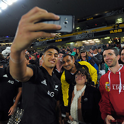 Rieko Ioane poses for a selfie with fans during the 2017 DHL Lions Series rugby union match between the NZ All Blacks and British & Irish Lions at Eden Park in Auckland, New Zealand on Saturday, 24 June 2017. Photo: Dave Lintott / lintottphoto.co.nz