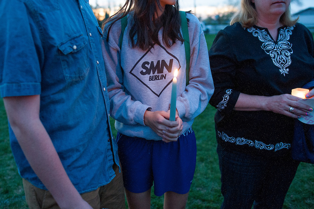 People attending the canglelight vigil on May 2, 2014 at the Fort Missoula soccer field where Diren Dede, a German exchange student, who was slain on April 27, 2014, played soccer.