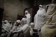 Ethiopian Orthodox worshippers await the Holy Fire ceremony at the Ethiopian section of the Church of the Holy Sepulchre in Jerusalem's Old City 03 April 2010