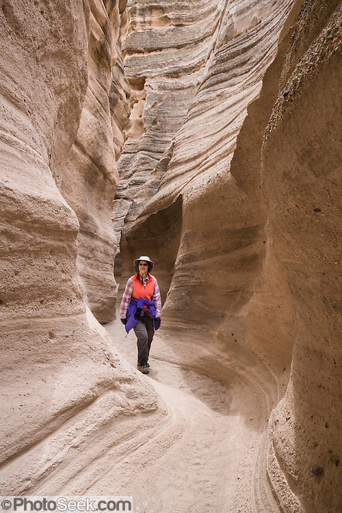 "Slot Canyon Trail. See fantastic hoodoos and a great slot canyon in Kasha-Katuwe Tent Rocks National Monument, in New Mexico, USA. Hike the easy Cave Loop Trail plus Slot Canyon Trail side trip (3 miles round trip), 40 miles southwest of Santa Fe, on the Pajarito Plateau. Distinctive cone-shaped caprocks protect soft pumice and tuff beneath. Geologically, the Tent Rocks are made of Peralta Tuff, formed from volcanic ash, pumice, and pyroclastic debris deposited over 1000 feet thick from the Jemez Volcanic Field, 7 million years ago. Kasha-Katuwe means ""white cliffs"" in the Pueblo language Keresan."