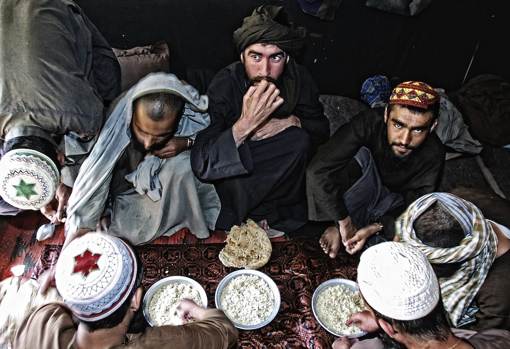 20011021-PANJSHIR VALLEY, AFGHANISTAN: The Taliban soldiers, captured during the secant fighting, take their food in the military prison for Taliban fighters not far from Sangana (about 200km from Kabul), 21 October, 2001.