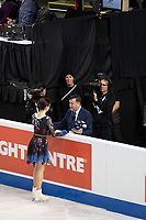 KELOWNA, BC - OCTOBER 26: Russian figure skater Evgenia Medvedeva stands at the boards with coach Brian Orser prior to ladies long program of Skate Canada International held at Prospera Place on October 26, 2019 in Kelowna, Canada. (Photo by Marissa Baecker/Shoot the Breeze)