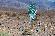 California state route 190 scenic byway sign and desert landscape - Death Valley National Park, California