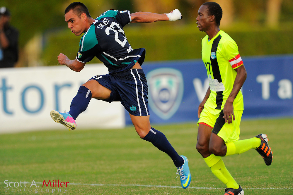 VSI Tampa Bay FC forward Mauricio Salles (23) in action against Antigua Barracuda in a USL Pro soccer match at Plant City stadium in Plant City, Florida on June 7, 2013. Salles had 5 goals as VSI won 8-0.<br /> <br /> &copy;2013 Scott A. Miller
