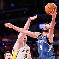 10 November 2013: Minnesota Timberwolves point guard Ricky Rubio (9) goes for the layup past Los Angeles Lakers center Chris Kaman (9) during the Minnesota Timberwolves 113-90 victory over the Los Angeles Lakers at the Staples Center, Los Angeles, California, USA.