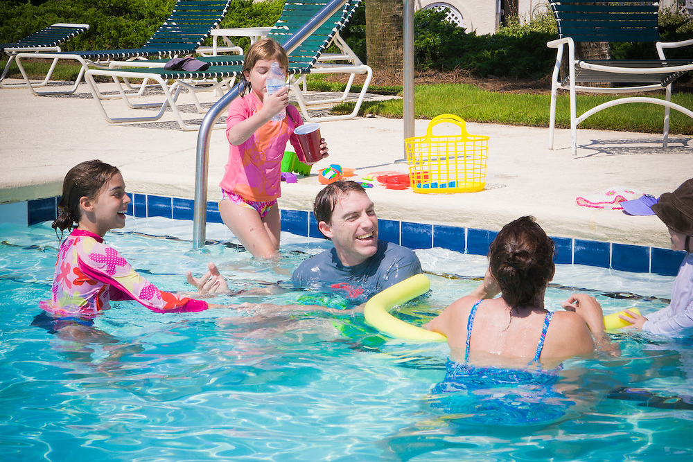 Chad Oakley, center, is surrounded by his family at the pool while vacationing on Pawley's island South Carolina; Wife Mindy, Daughters Catie, far left, Summer, left, and son Chase, far right. Chad owns an Executive recruiting firm in Greensboro, North Carolina.