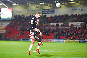 Mike-Steven Bahre of Barnsley (21) heads the ball on during the EFL Sky Bet League 1 match between Doncaster Rovers and Barnsley at the Keepmoat Stadium, Doncaster, England on 15 March 2019.