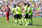 Brighton players congratulate Tomer Hemed of Brighton & Hove Albion after his penalty goal  during the Pre-Season Friendly match between Brighton and Hove Albion and Sevilla at the American Express Community Stadium, Brighton and Hove, England on 2 August 2015. Photo by Phil Duncan.