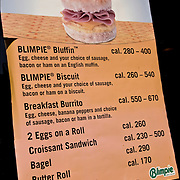 Breakfast sandwiches, Biimpie's sign in window, fast food chain of 15 or more stores have to post the number of calories of different food items in NYC