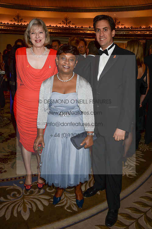 Left to right, the Home Secretary THERESA MAY MP, BARONESS LAWRENCE OF CLARENDON and ED MILIBAND MP Leader of the Labour party at the inaugural Stephen Lawrence Memorial Ball held at The Dorchester, Park Lane, London on 17th October 2013.