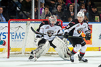 KELOWNA, CANADA - MARCH 16:  Yannik Valenti #20 and David Tendeck #30 of the Vancouver Giants defend the net against the Kelowna Rockets on March 16, 2019 at Prospera Place in Kelowna, British Columbia, Canada.  (Photo by Marissa Baecker/Shoot the Breeze)