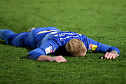 AFC Wimbledon midfielder Mitchell (Mitch) Pinnock (11) laying on the pitch face down during the EFL Sky Bet League 1 match between AFC Wimbledon and Peterborough United at the Cherry Red Records Stadium, Kingston, England on 18 January 2020.