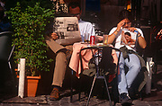 A cafe couple read a copy of Correre della Sera newspaper and a womens' magazine in the Italian capital, on 3rd November 1999, in Rome, Italy.
