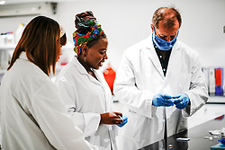 Scientists and technicians involved in the research, development and manufacture of Corona Virus Testing Kits in a laboratory facility near Cape Town, Western Cape, South Africa, RSA