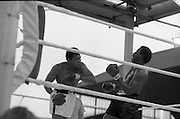Ali vs Lewis Fight, Croke Park,Dublin..1972..19.07.1972..07.19.1972..19th July 1972..As part of his built up for a World Championship attempt against the current champion, 'Smokin' Joe Frazier,Muhammad Ali fought Al 'Blue' Lewis at Croke Park,Dublin,Ireland.  Muhammad Ali won the fight with a TKO when the fight was stopped in the eleventh round...Image of Ali as he rocks Lewis with a left cross.